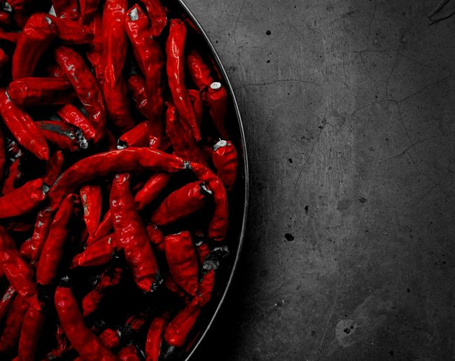 Close-Up Of Red Chilies On Table