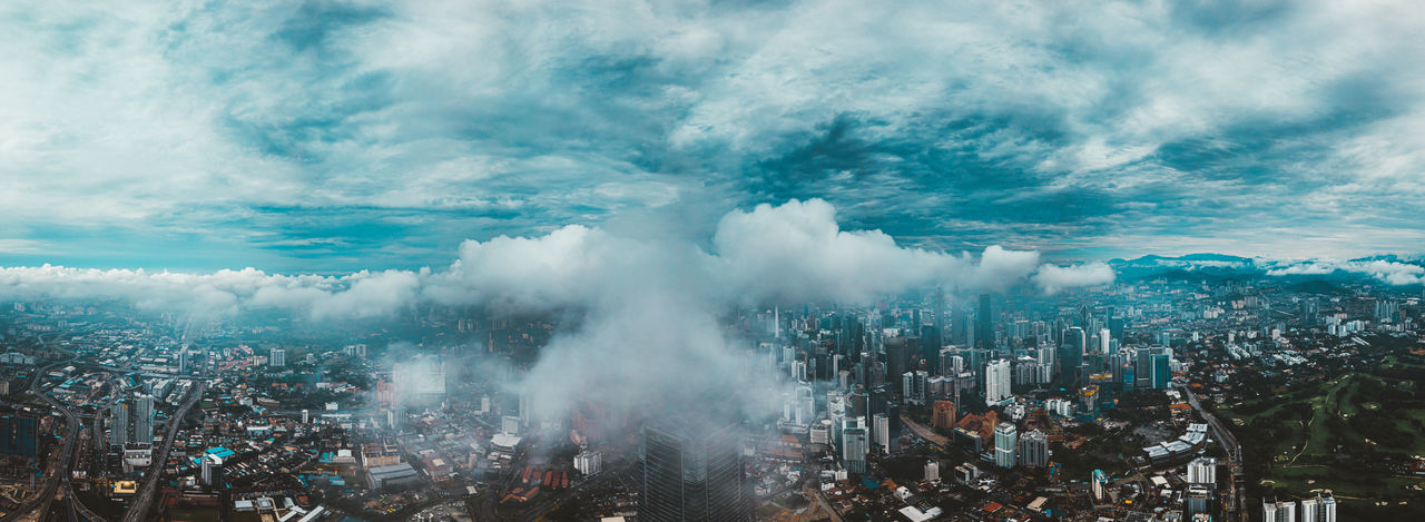 High angle view of city against cloudy sky