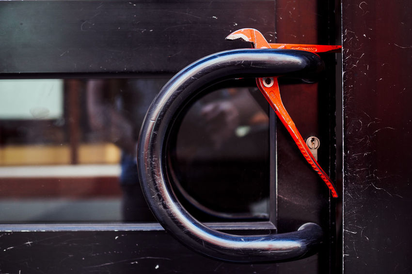 Blocked Black Color Blocked Close-up Closed Day Door Entrance Focus On Foreground Glass - Material Handle Indoors  Metal Mode Of Transportation No People Orange Color Pliers Red Reflection Safety Security Window Wood - Material