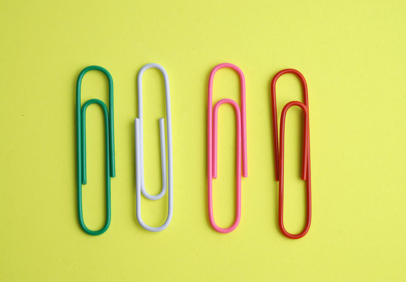 Paper clip on yellow background Conceptual New Background Book Noted Paper Education Neat Paper Clip Office Multi Colored Business Finance And Industry Arrangement Business In A Row Close-up Colored Pencil Various Organization Medium Group Of Objects For Sale Repetition Display Order Clip Archives Filing Cabinet Knolling - Concept Shelves