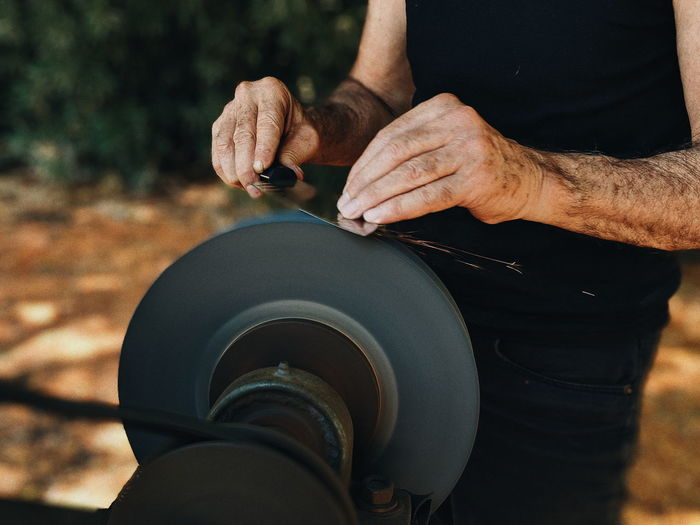 Day Equipment Finger Focus On Foreground Hand Holding Human Body Part Human Hand Land Lifestyles Men Midsection Occupation One Person Outdoors Real People Skill  Sunlight Working