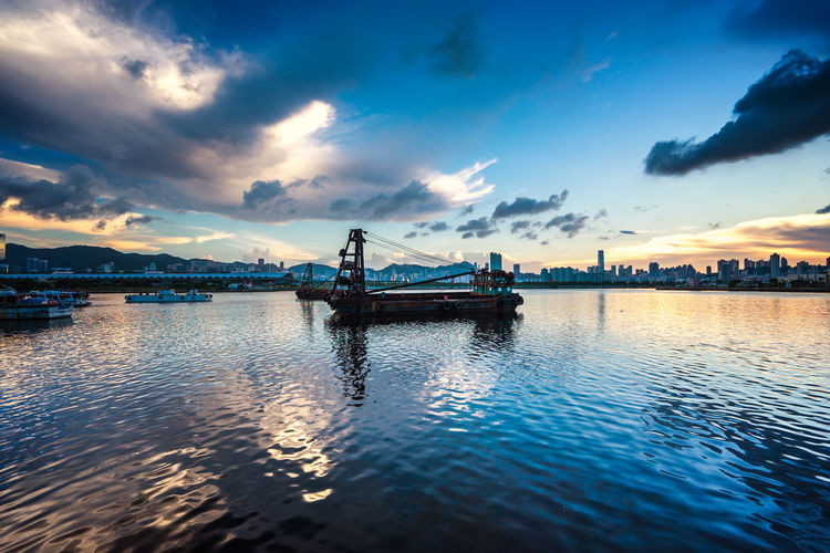 Barges In Kowloon Bay Against Sky
