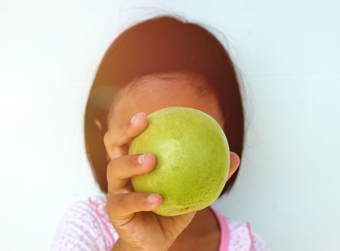Close-up of woman holding apple