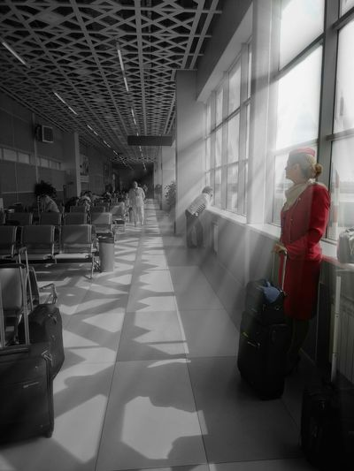 The girl in the airport terminal Aviationphotography Travelphotography Blackandwhite Splash Model Shoot Model Pose Airport Terminal Station Airline Air Hostess Natural Light Sunrays Uniform Buidling Interior Termina Urban Scene Building Exterior