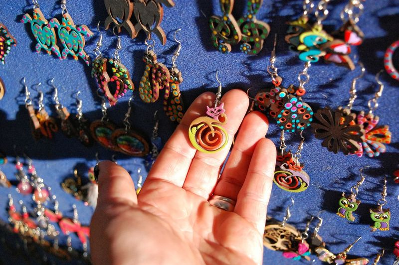Cropped hand holding earring at market
