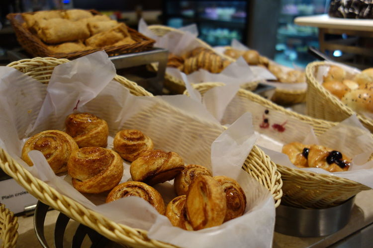 Close-up of fresh baked pastries in baskets at store