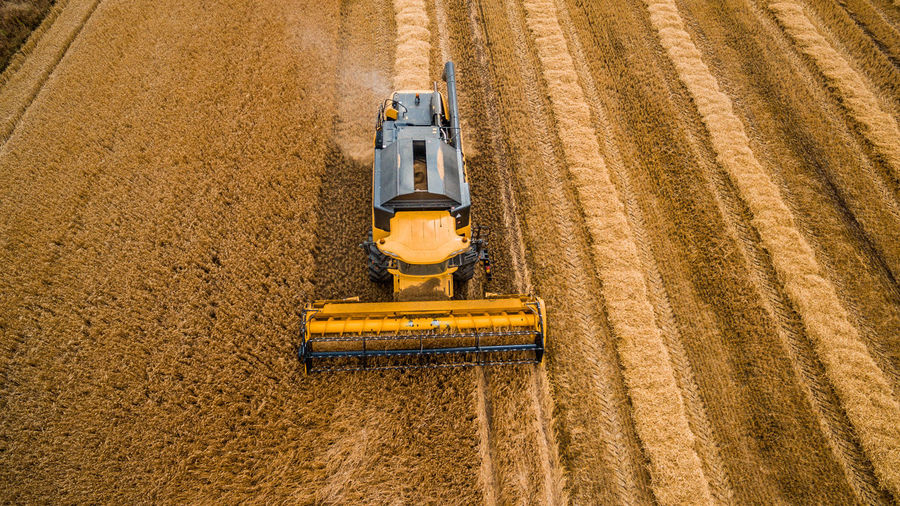 High Angle View Of Combine Harvester In Field