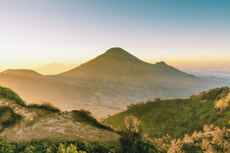 My country, Indonesia has many beautiful mountains and it's make me love to seeing sunrise from the top of the mountain. Mountain Misty Morning Hiking Adventure INDONESIA Nature My Best Travel Photo Tree Mountain Dawn Fog Forest Multi Colored Sky Landscape Plant Mountain Peak Mountain Ridge Sunrise - Dawn Valley Terraced Field
