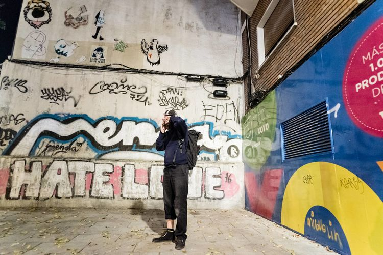 Madrid trip 2016 Adult Adults Only Art And Craft Artist Creativity Day Full Length Graffiti Leisure Activity Madrid One Man Only One Person Only Men Outdoors People SPAIN Spray Paint Standing Street Art Wall - Building Feature Young Adult