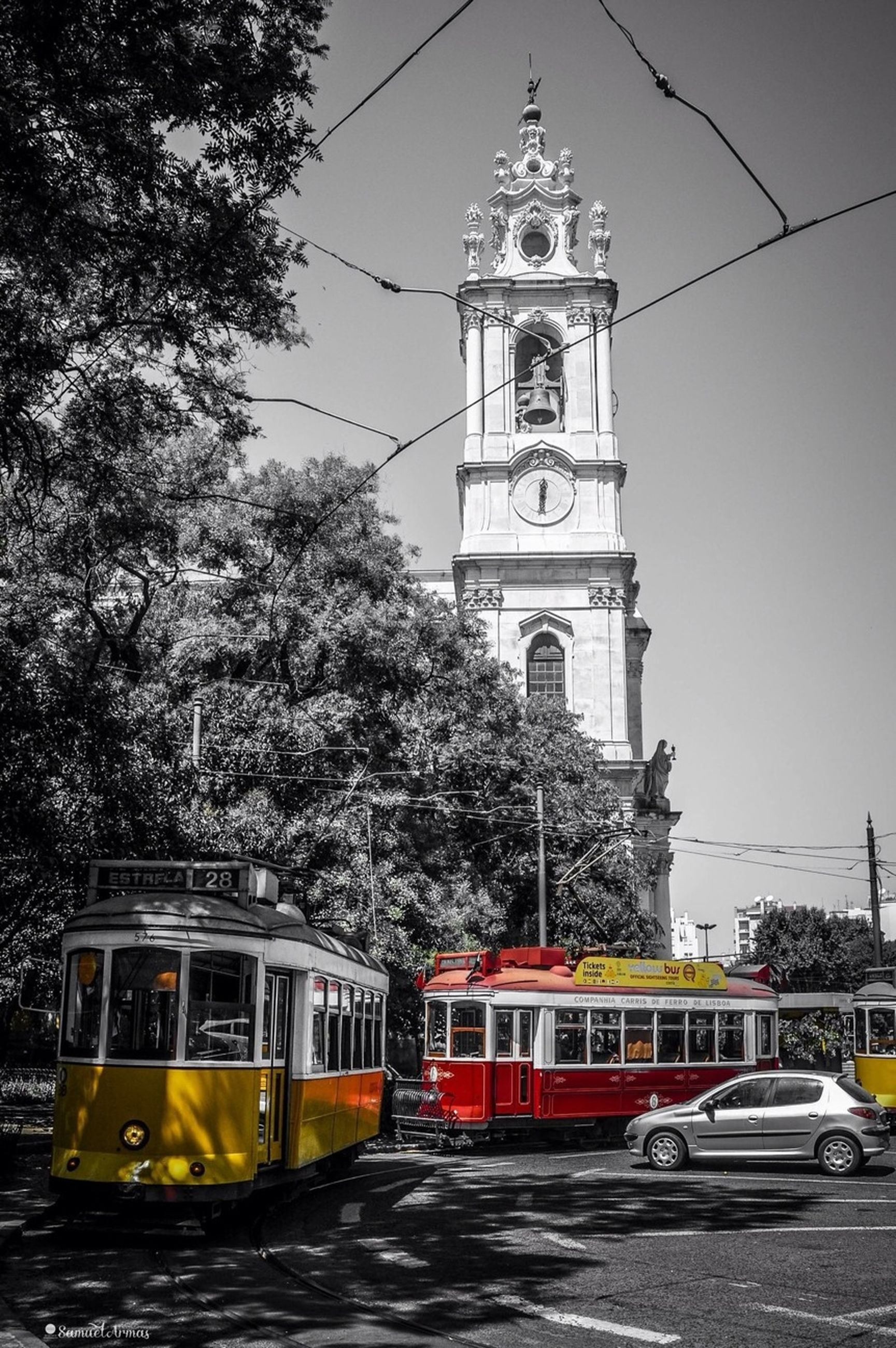 transportation, building exterior, architecture, built structure, mode of transport, land vehicle, church, tree, religion, car, street, road, clear sky, travel, clock tower, public transportation, clock, place of worship, tower
