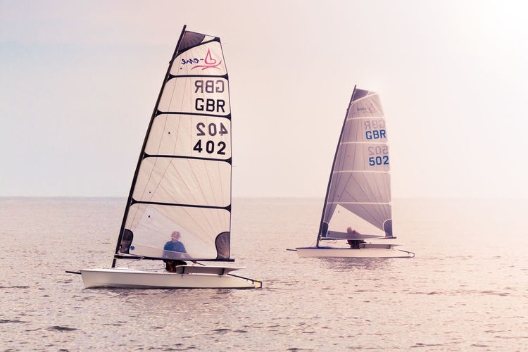 Beach Boat Horizon Over Water Leisure Activity Lifestyles Ocean Outdoors Race Sail Sailing Sea Showcase July Sky Water