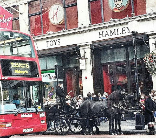 Horse And Carriage London Bus London England Travelphotography Hamley the oldest toy store in the world