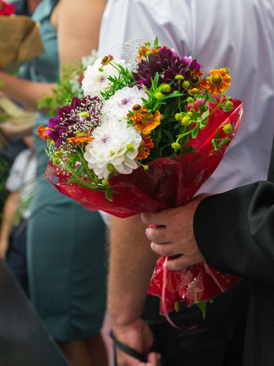 Cropped Hand Of Man Holding Bouquet