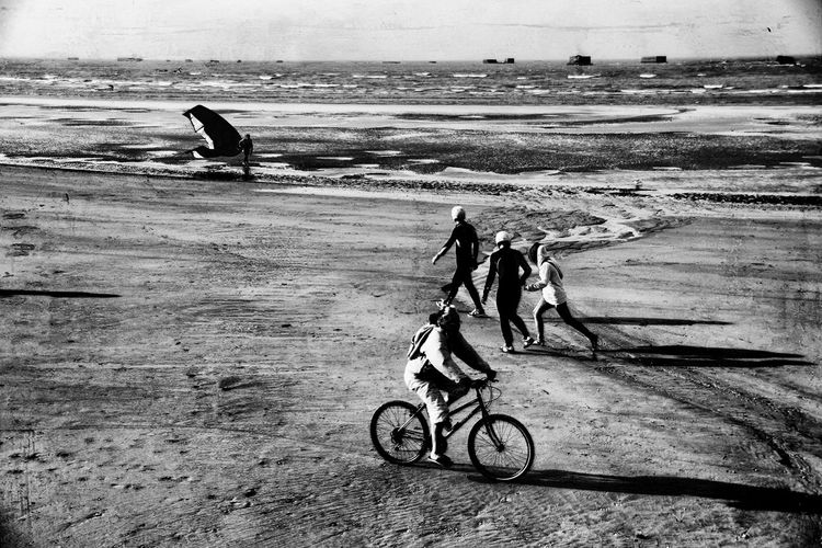 Atlantic shore-low tide A Artistic Artistic Vision Atlantic Ocean Atlantic Ocean Road Beach Bicycle Black And White Classic France Light And Shadow Live Low Tide Men Monochrome Normandie Ocean Outdoors People Sea Sea Shore Transportation Vision Water