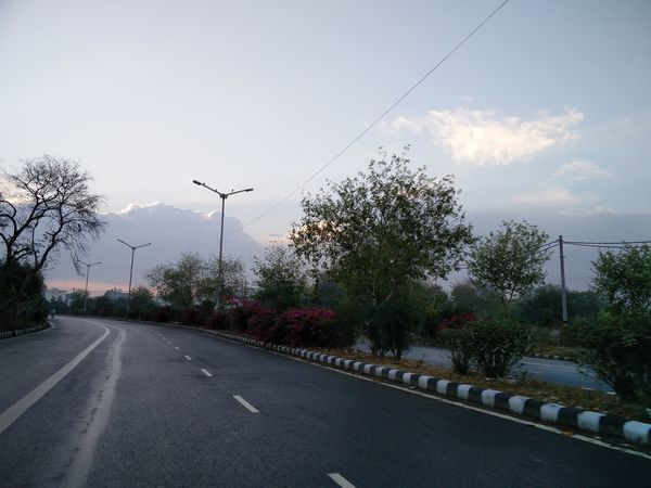 Taking Photos No Filter Beautiful Beautiful Nature Beauty In Nature Lovely Weather Morning Morning Sky Road Trees Sky Sky And Clouds The Way Forward Road Marking Empty Road Sunrise - Dawn Dividing Line