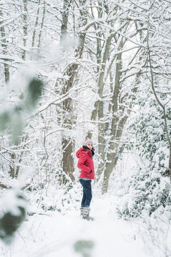 Young woman with red jacket in winter landscape with snow in Germany Winter Snow One Person Cold Temperature Warm Clothing Clothing Snowing Nature Standing Day Leisure Activity Real People Lifestyles Beauty In Nature Outdoors Extreme Weather Bonn Germany Rhine Valley Forest Wintertime Winter Wonderland Winter Trees
