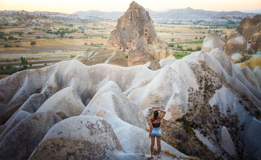 Cappadocia Hiking Travel Adult Adults Only Beauty In Nature Day Full Length Headwear Hikingadventures Landscape Leisure Activity Mountain Nature One Person One Woman Only Outdoors People Real People Rock - Object Scenics Sky Standing Young Adult