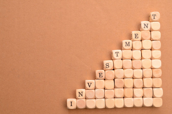 Investment Alphabet Arrangement Beige Background Childhood Close-up Communication Computer Key Concert Day Financial District  Indoors  Investment Large Group Of Objects Money No People Rich Still Life Studio Shot Upswing Wood - Material