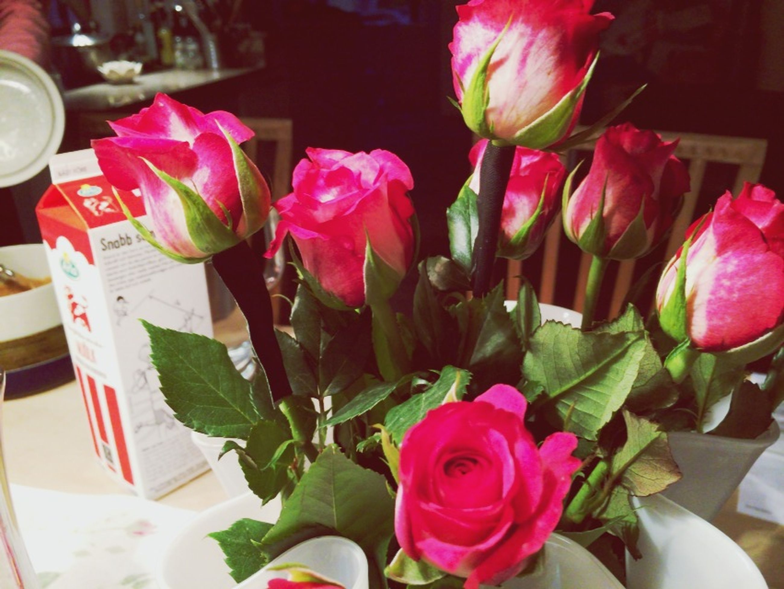 flower, freshness, petal, pink color, indoors, fragility, flower head, close-up, beauty in nature, vase, rose - flower, growth, table, bouquet, nature, pink, flower arrangement, bunch of flowers, focus on foreground, plant