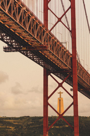 The 25 de Abril Bridge over the Tagus river in Lisbon, Portugal 25 De Abril Bridge Architecture Christus-Statue Discover Your City Lisabon Red Travel Photography Traveling Aroundtheworld Bridge Bridge - Man Made Structure Discovery Red Bridge Travel Destinations