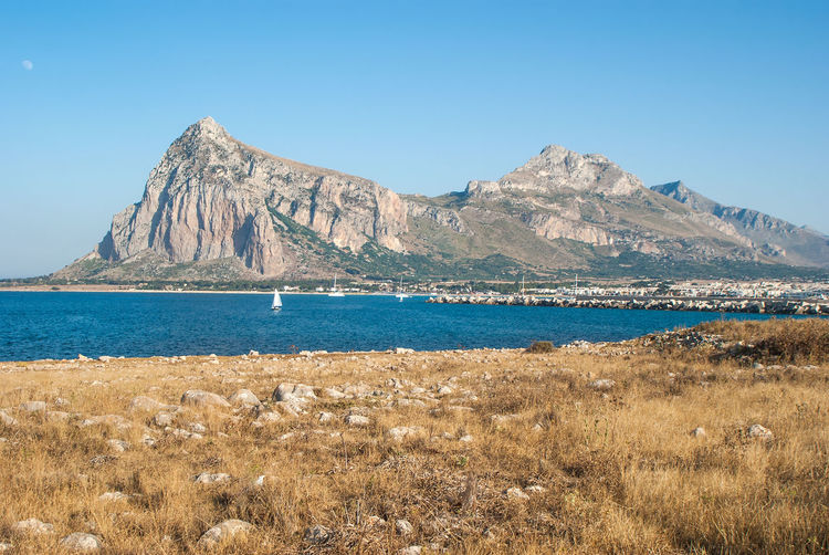 Beautiful View of San Vito Lo Capo town in Sicily San Vito Lo Capo Sicily Beach Beachphotography Beauty In Nature Blue Clear Sky Day Environment Grass Land Mountain Mountain Peak Mountain Range Nature No People Non-urban Scene Outdoors Plant Scenics - Nature Sea Sky Tranquil Scene Tranquility Water