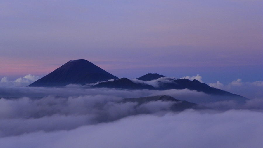 Bromo volcanic complex in early morning light, Java, Indonesia Beauty In Nature Bromo Cloud - Sky Clouds Complex Volcano EyeEmNewHere Fog Idyllic INDONESIA Java Mountain Nature No People Outdoors Scenics Sky Sunrise Sunset Tranquil Scene Tranquility Traveling Volcanic Complex Volcanic Landscape Volcano