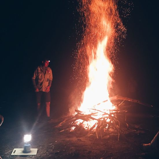 Heat - Temperature Fire - Natural Phenomenon Burning Flame Glowing Real People Night One Person Danger Standing Motion Men Outdoors Working Flaming Torch Adults Only Only Men Occupation Nature