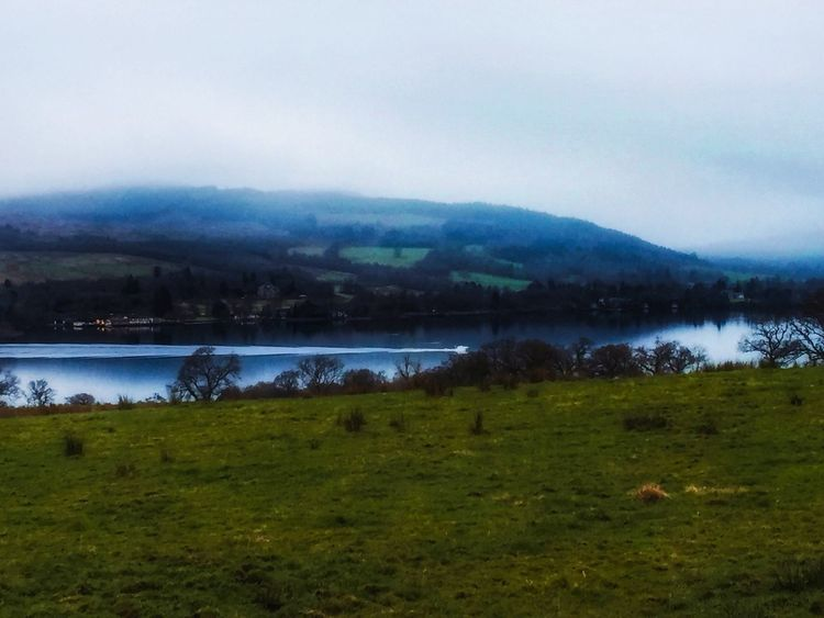 Green Grassy Water Hills Horizon Over Land Scenics Outdoors Landscape Tranquil Scene No People Lake Day Architecture Rural Today In Scotland Boat Beauty In Nature Wake Pattern Foggy Overcast Dullday Dull But Beautiful
