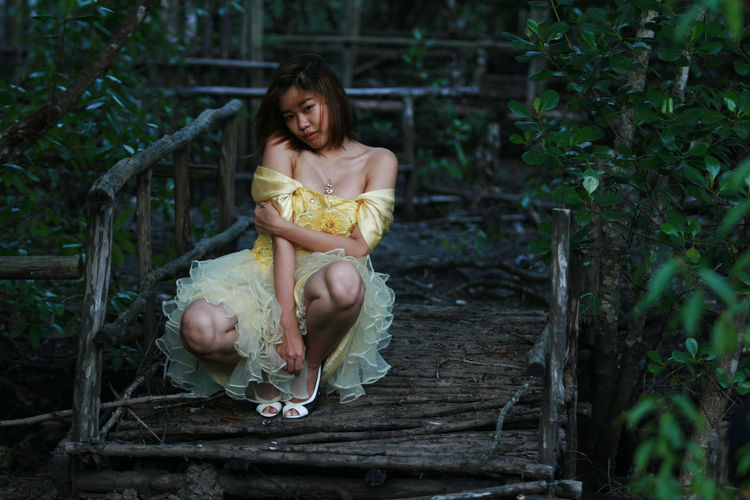 Young woman posing in dress outdoors