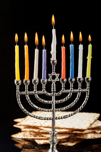 Menorah with lighted candles for Hanukkah on a black in the background. Anniversary Baked Birthday Birthday Cake Birthday Candles Black Background Burning Cake Candle Celebration Chanuka Chanukah Dark Dessert Event Fire Fire - Natural Phenomenon Flame Food Food And Drink Hanukkah Illuminated Indoors  Matzo Matzoth Menorah Studio Shot Temptation