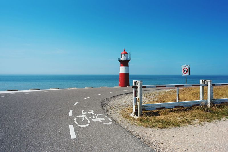 Lighthouse Safety Communication Horizon Over Water Guidance Sea Tranquility Scenics Lighthouse Dutch Red White Blue Sky Ocean View Landscape Nikon Nikonphotography Nikond750 Road Oceanroad
