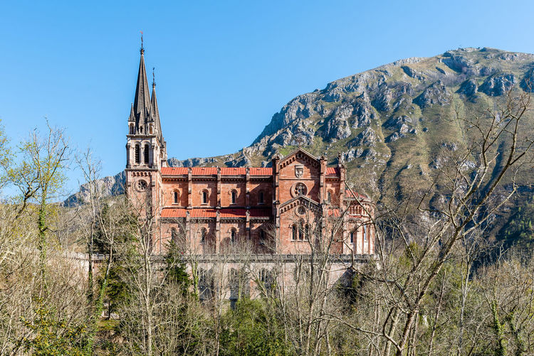 Basilica of Covadonga in Asturias Architecture Day No People Nature Reconquest Covadonga Asturias Asturias Paraiso Natural🌿🌼🌊🌞 SPAIN Europe Pilgrimage Basilica Landmark Church Mountains Sky Built Structure Tree History The Past Plant Building Exterior Clear Sky Building Blue Religion Low Angle View Travel Destinations Outdoors Belief Place Of Worship Old