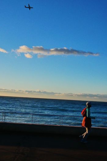 Plane Sea Real People Beach One Person Full Length Sky Press For Progress Water The Street Photographer - 2018 EyeEm Awards