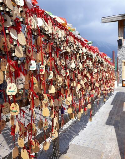 China Yunnan ,China Jade Snow Mointain Sky Close-up Padlock Love Lock Hope Faith Chain Luck Attached Locked Chainlink Fence