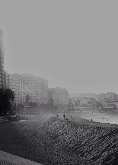 Adapted To The City Building Exterior Real People Outdoors Sky Day Atlantic Ocean Playtime Nature In The City Coruña Beach Day Beachinthecity Galicia, Spain Good Times Blancoynegro Blackandwhite Photography Peace And Quiet Cityscape Walking Around The City  Lifestyle
