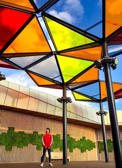 Rainbow Real People Sky One Person Architecture Built Structure Lifestyles Leisure Activity Cloud - Sky Men Adult Full Length Casual Clothing Building Exterior Outdoors Day Women Rear View Nature Standing