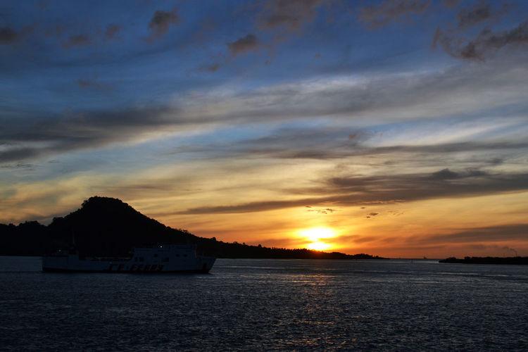 Sunrise in Sunda on the way to Merak port INDONESIA Lampung Morning Morning Sun Beauty In Nature Blue Blue Sky Cloud - Sky Nature No People Outdoors Scenery Scenics - Nature Sea Ship Silhouette Sky Strait Sun Sunrise Sunset Water EyeEmNewHere