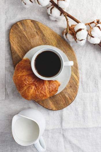 Cup of black coffee with croissant and milk on table. The concept of breakfast, flat lay, top view. Coffee Croissant Breakfast Morning Cup Cappuccino Background Drink Top Pastry Table Latte Cafe Espresso White Hot Americano View Caffeine Bread Food Dessert Fresh Brown Rustic Break Linen Minimalist Minimal Cotton Beige Golden Atmosphere Sweet Above Flat Lay Composition Ceramics Mug Black Milk Cream Beverage Time Food And Drink The Foodie - 2019 EyeEm Awards