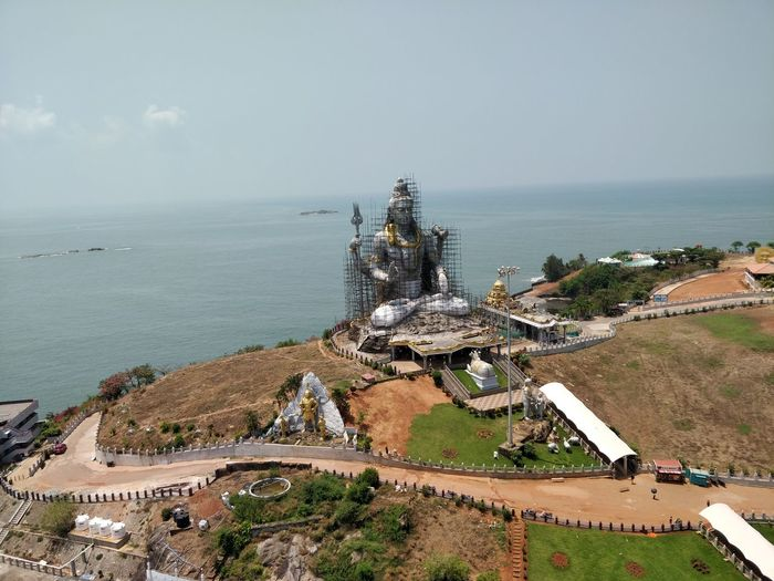Murudeshwara Temple... Temple Architecture Temple Templephotography India Statue Indiapictures Indian Culture  Arabiansea Ocean View Horizon Over Water Coastal Region Sea Horizon Over Water Business Finance And Industry Day Building Exterior Nature Beach Water Stories From The City The Traveler - 2018 EyeEm Awards The Great Outdoors - 2018 EyeEm Awards