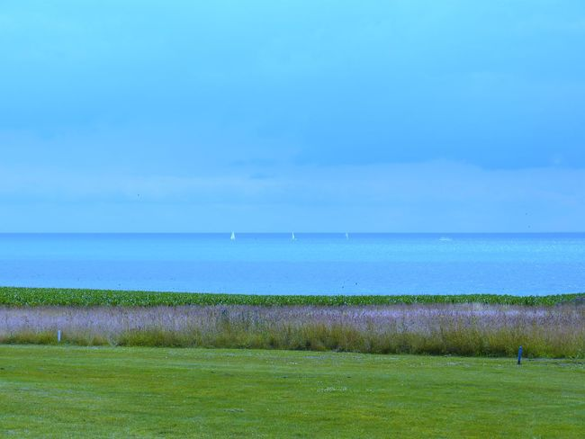 Golfplatz am Meer, Wulfen, Fehmarn, Germany Beauty In Nature Blaugrün Day Field Golfplatz Am Meer Grass Green Color Growth Horizon Over Water Landscape Nature No People Outdoors Rasen Scenics Sea Sky Tranquil Scene Tranquility Water