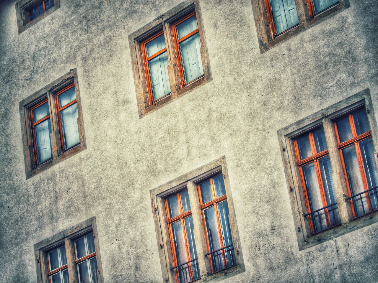 window, architecture, building exterior, building, residential district, built structure, no people, low angle view, day, outdoors, city, house, wall - building feature, glass - material, nature, cloud - sky, facade, multi colored, old, townhouse, row house, apartment, window frame