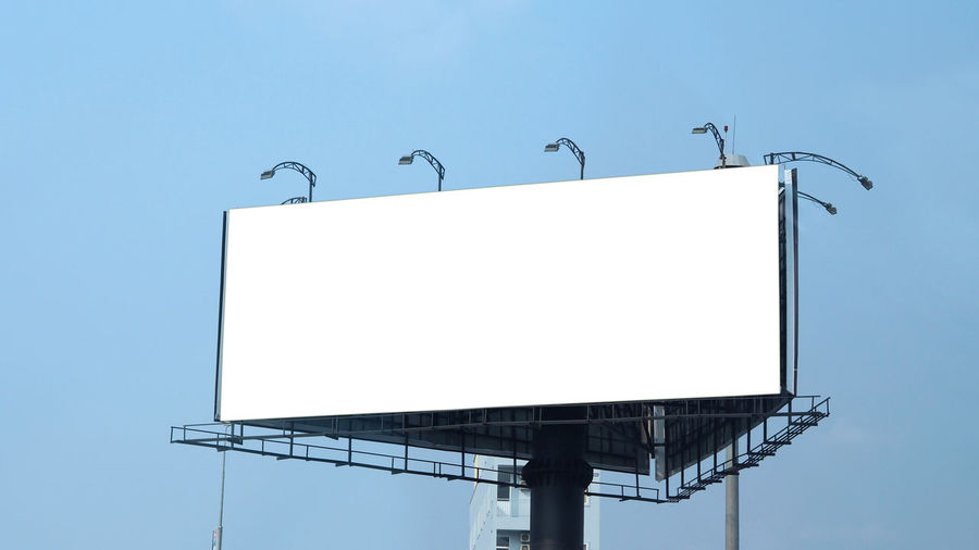 Blank billboard large size for outdoor or out of home advertising with blue sky. Advertisement Architecture Billboard Billboard; Blank; Outdoor; Background; Mockup; Advertising; Advertisement; Sky; Poster; Blue; Business; Banner; Space; Media; Communication; Commercial; Marketing; White; City; Large; Message; Promotion; Mock; Up; Sign; Board; Empty; Frame; Outside; Displ Blank Blue Building Exterior Built Structure Clear Sky Communication Copy Space Day Geometric Shape Low Angle View Nature No People Outdoors Sign Sky Sunlight White Color