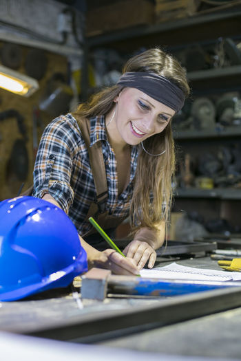 Portrait of a smiling young woman working