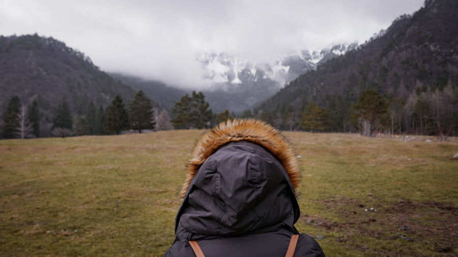 Mountain One Person Clothing Rear View Winter Cloud - Sky Mountain Range Plant Adult Sky Nature Tree Scenics - Nature Day Beauty In Nature Leisure Activity Environment Warm Clothing Hair Hood - Clothing Outdoors Looking At View EyeEmNewHere EyeEm Best Shots Stay Out