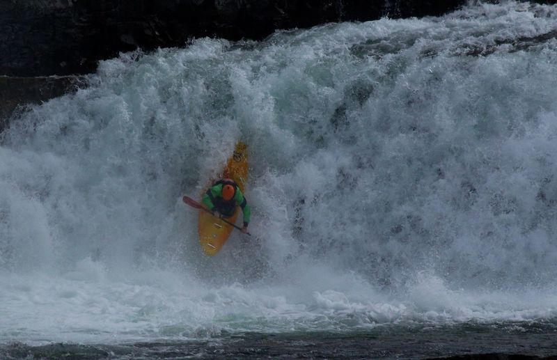 Man Canoeing In Water