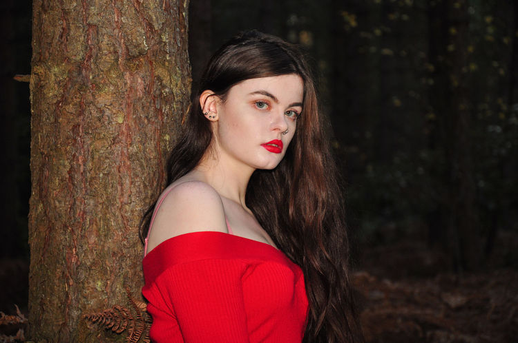 Beautiful young lady in a red jumper in a forest in the autumn Girl Millenial Young Lady Red Red Color Red Lipstick Forest Trees Beauty Beautiful Woman Beautiful Long Hair Portrait Portrait Of A Woman Portrait Photography Tree Trunk Red Jumper Off The Shoulder Stunner Beautiful Young Lady Beautiful Young Woman One Person Trunk Tree Looking At Camera Hair Women Fashion
