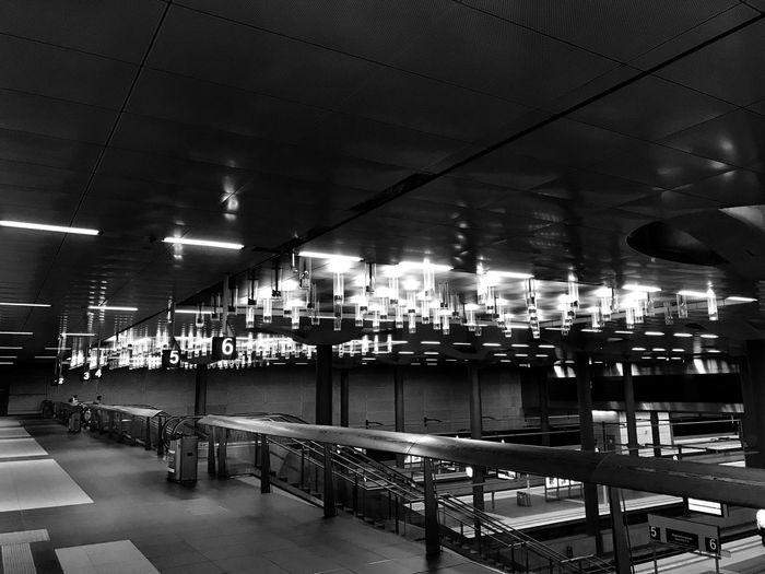 Empty seats in illuminated city at night