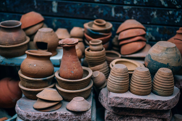 Stack of earthenware for sale in market