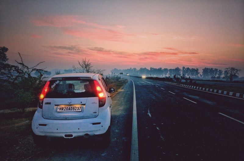 Journey is life EyEmNewHere No People Car Mode Of Transport Sky Road Day Outdoors Transportation Sunrise Landscape_photography Pinksky