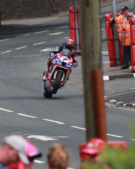 Transportation Mode Of Transportation Road Motorcycle Street Speed Headwear Helmet Group Of People People High Angle View on the move Outdoors Crash Helmet Riding Sports Race Motion Wheelie Isle Of Man Isle Of Man TT Douglas Fast Racer Racing Motorcyle Racing